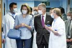 17-04-2020 Belgium Queen Mathilde of Belgium and King Philippe - Filip of Belgium discuss with the hospital staff during a royal visit to several services at the Liege Citadelle hospital (Centre Hospitalier Regional (CHR) in Liege.