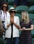 04-07-2019 Duchess of Sussex, Meghan Markle  (2nd R) applauds after Serena Williams of the United States winning the women's singles second round match with Kaja Juvan of Slovenia at the 2019 Wimbledon Tennis Championships in London, Britain  