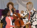 25-05-2016 Den Bosch Queen Maxima, presenting a childrens cello to the 9 year old Rashida, at the start of the project ��Classic Shows�� ( Klassiek Geeft) of the NPO Radia 4 at the Kruisboelijn school in �s-Hertogenbosch.