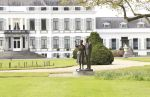 16-05-2017 Baarn Exterieur of palace Soestdijk, former palace of the Dutch Royal Family, with a statue of late Queen Juliana and Prince Bernhard in the garden in Baarn.