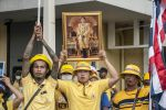 09-11-2020 Thai A protester holds a portrait of Thailand King Maha Vajiralongkorn (Rama X) during the demonstration.