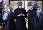 17-11-2020 Seraing Queen Mathilde and King Filip of Belgium wear a face shield and a mouth mask as they meat a patient in her room at a royal visit to the 'Centre Hospitalier Bois de l'Abbaye' hospital in Seraing, Liege province.