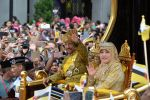 05-10-2017 Brunei's Brunei's Sultan Haji Hassanal Bolkiah (2nd R, Front) waves to the crowd during a Royal Procession in Bandar Seri Begawan, capital of Brunei