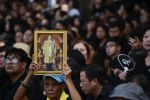 07-10-2017 Thai mourner holds a portrait of the late Thai King Bhumibol Adulyadej during a funeral rehearsal for late Thailand's King Bhumibol Adulyadej near the Grand Palace in Bangkok, Thailand.