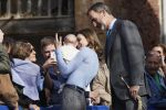 21-10-2017 Spain Queen Letizia, holding a baby, and King Felipe talked with residents during their visit to Porenu village as they award the town with the 2017 ''Exemplary town of Asturias award'', in Porenu, Spain.