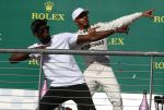 22-10-2017 USA British Formula One driver Lewis Hamilton of Mercedes AMG GP (R) poses with Usain Bolt (L) on the podium after the race at the Circuit of the Americas, in Austin, Texas, USA